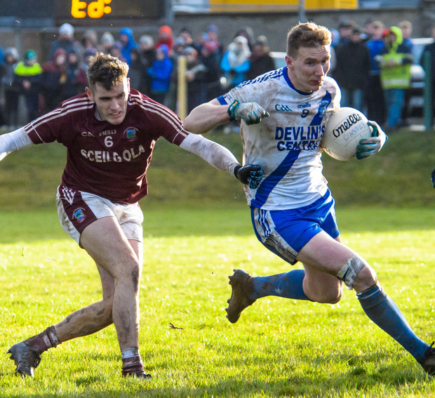 Denis Daly of St. Mary's with the ball closely being tackled by Graham Ó Súilleabhain of Piarsaigh Na Dromoda during the South Kerry Senior Championship final in Portmagee. Photo by Stephen Kelleghan