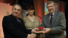 President of the GAA Nickey Brennan in the company of Carolan Lennon, Director of Marketing, Vodafone, presents Donie O'Sullivan, a member of the Football All Stars of 1971, with a commemorative medal to mark the 35th anniversary of the Vodafone GAA All-Star Awards scheme at a special celebration in Croke Park in November 2006. Photo: Ray McManus / SPORTSFILE