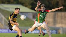 Mid Kerry's Peter Crowley puts Micheál Burns, Dr Crokes, under pressure during last Saturday evening's Garvey's County Senior Football Championship semi-final at Austin Stack Park, Tralee. Photo by Domnick Walsh / Eye Focus