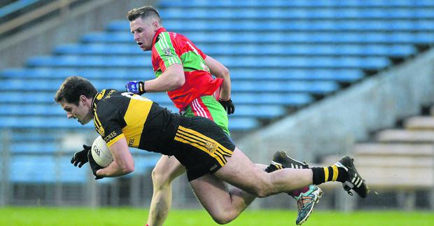 Eoin Brosnan, Dr. Crokes, in action against Philip McMahon, Ballymun Kickhams. Picture credit: Diarmuid Greene / SPORTSFILE