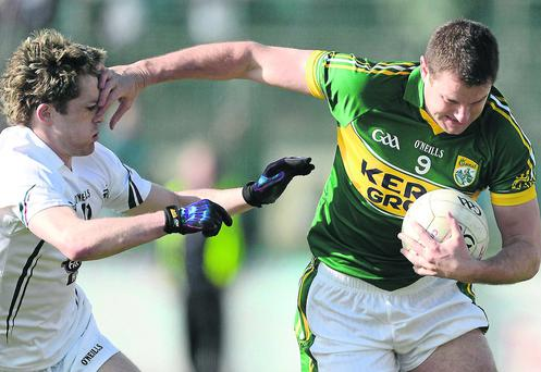 Eoin Brosnan - in action against Niall Kelly of Kildare - is favourite to line out at centre-back