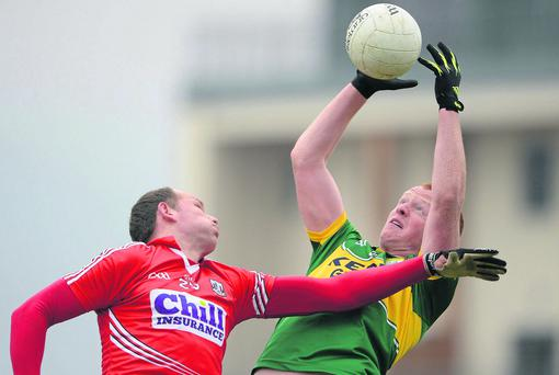 Johnny Buckley, Kerry, fields a high ball ahead of Alan O'Connor, Cork. Allianz Football League, Division 1, Kerry v Cork, Austin Stack Park, Tralee, Co. Kerry. Picture credit: Brendan Moran / SPORTSFILE