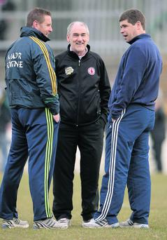 Tyrone manager Mickey Harte in conversation with Kerry manager Eamon Fitzmaurice, right, and Kerry trainer Cian O'Neill. Stephen McCarthy / SPORTSFILE