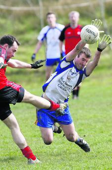 Keel's Aaron Cahillane gets in a great block down on Niall Stack, Tarbert, in their JFC game in Tarbert on Sunday. Photos by John Stack