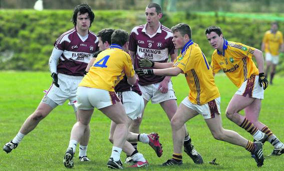 Scartaglin corner back Declan O'Mahony fighting his way out of a combined Duagh attacking force of Tim Scanlon, Kieran Duffy and Timmy Quirke as Scartaglin's Pádraig Reidy and Tim Coakley arrive to support their team-mate. Photo by John Reidy