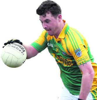 Finuge corner forward and captain Raymond Galvin has to work his way around Laune Rangers full forward, Mike Frank Russell during their Castleisland Co-Op Mart Co. Senior Club Football Championship game in Finuge on Sunday afternoon. Photo by John Reidy