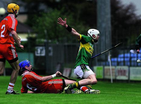 n Kerry corner forward, Shane Nolan trying to control this ball in spite of the challenges of Derry centre back, Liam Henphey and corner back, Michael Warn