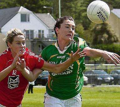 Aoife Lyons of Kerry reaches for the ball while under pressure from Orla Finn of Cork during the Ladies Munster senior round one match in Caherciveen