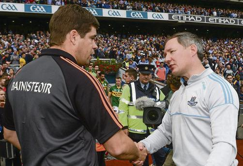 Dublin manager Jim Gavin, right, shakes hands with Kerry manager Eamonn Fitzmaurice after the game.