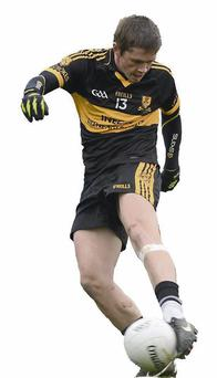 Chris Brady, Dr. Crokes, shoots to score his side's first goal.
