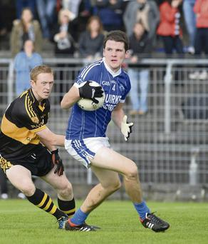 Shane Brosnan (Kerins O'Rahilly's) and Colm Cooper (Dr Crokes) in action during the game.