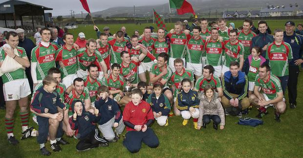 St.Michael/Foilmore celebrate after winning to Piarsaigh na Dromoda in the South Kerry Senior football final in Caherciveen. Photo: Stephen Kelleghan