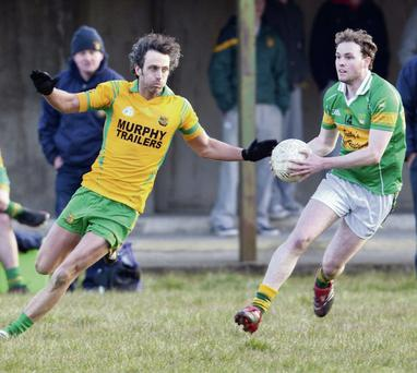 Gneeveguilla and John Mitchels - with Liam Murphy and Niall Sheehy in action above - will be just two clubs in a very competitive Division Two that will have ambitions of winning promotion to the top flight of senior football this year