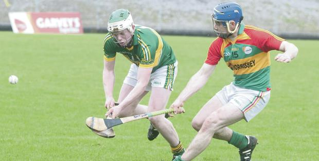 Kerry's Daniel Collins and Carlow's Paudie Kehoe go for the ball at Austin Stack park.