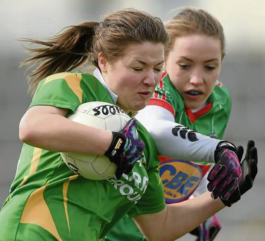 Claire O'Sullivan, Kerry, in action against Leona Ryder, Mayo. Picture: Barry Cregg / SPORTSFILE