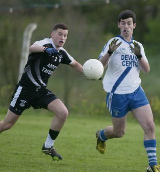 St Mary's Sean Courane gets in front of Ardfert's Fionan Horgan in the county intermediate championship.