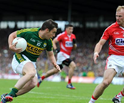 Kerry's Stephen O'Brien chased by Michael Shields, Cork