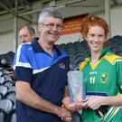 Kerry captain Cait Lynch collects the cup after the Kingdom's stunning victory over Cork in the Munster ladies final