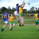 Kieran Murphy, Glenflesk, breaks the ball down against Don Murphy, Gneeveguilla, in the Kerry County League in Gneeveguilla on Friday