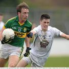 Donnchadh Walsh in action against Mick O'Grady during the last meeting of the counties, in last year's Allianz Football League in Newbridge. Both players are expected to be central to the action when the teams meet in Croke Park on Sunday