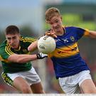 Kerry's Darren Brosnan in action against Tipperary's Brendan Martin