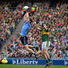 Rory O'Carroll, Dublin, wins a dropping ball ahead of Paul Geaney, Kerry