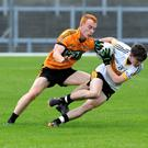Jordan Kiely (Dr Crokes) chased by Shane O'Callaghan (Austin Stacks) in the Kerry County Garvey's SuperValu Senior Football Championhsip in Fitzgerald Stadium, Killarney