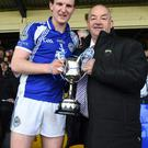 Templenoe Captain Tadhg Morley receiving the Kerry County Castleisland Mart Junior Football Cup at Fitzgerald Stadium, Killarney on Sunday