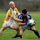Templenoe defender John Spillane holds on to the ball as Bandon's Alan Johnson attempts to dispossess him