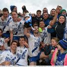 St Mary's players and supporters celebrate following their victory against Carrigaline