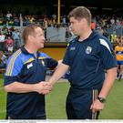 Clare manager, Colm Collins, left, and Kerry manager, Eamonn Fitzmaurice - shaking hands after the 2014 Munster SFC semi-final in Cusack Park, Ennis - will be in opposition again this Sunday in the McGrath Cup in Killarney
