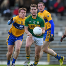 Damien O'Sullivan, Kerry, in action against Sean Collins, Clare