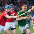 Kerry's Michael O'Leary wins possession and tries to break past Cork's Colm Barry during last weekend's Munster Senior Hurling League game played in Mallow