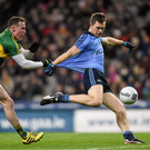 Kerry full back tests the strength of Dean Rock's jersey during their Allianz Football League Division 1 game in Croke Park