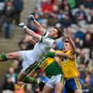 Kerry goalkeeper Brian Kelly punches the ball clear under pressure from Diarmuid Murtagh, Roscommon, and supported by Shane Enright in Sunday's Allianz National Football League Division 1 semi-final in Croke Park. Photo: Sportsfile