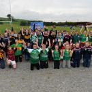 Some of the young people from Cork, Limerick and Kerry at the launch of the John West Feile Peil na nÓg Launch in Brosna GAA club grounds Monday