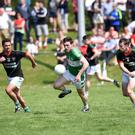 Shaun Keane Legion chased by Jeremiah Hayes and Paul Carroll Milltown Castlemaine in the Garvey's Supervalu Kerry County Senior Football Championship Round 1 in JP O'Sullivan Park, Killorglin on Sunday. Photo by Michelle Cooper Galvin