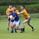 Ciaran Doona, Laune Rangers, under severe pressure from Eoin Cronin and Dan O'Donoghue Spa in the Kerry County Credit Union League at Spa, Killarney on Sunday. Photo by Michelle Cooper Galvin
