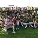 The Kerry players celebrate winning the Munster JFC title for the third year in a row