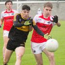 Dr Crokes' Tony Brosnan, left, in action with Dingle's Conchúbhar Ó Súilleabhain in the Acorn for Life Under-21 Football Championship semi-final at Kerins O'Rahillys GAA grounds last Thursday
