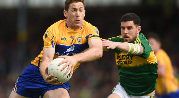 Gary Brennan of Clare in action against Michael Geaney of Kerry during their Munster GAA Football Senior Championship Semi-Final match at Fitzgerald Stadium