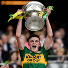 Kerry captain Seán O'Shea lifts the Tom Markham Cup. Photo by Seb Daly/Sportsfile