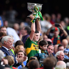 Kerry captain Seán O'Shea lifts the Tom Markham Cup after the All-Ireland Minor Football Championship Final win over Galway at Croke Park on Sunday. Photo by Sportsfile