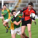 Kenmare's Sean O'Shea well caught by Kilfenora's no 11 in the Munster Semi-final at Fitzgerald Stadium, Killarney on Sunday. Photo by Michelle Cooper Galvin