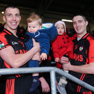 Kenmare players Mark Crowley, with his son Flynn, and Shane Dalton with his daughter Eabha, celebrate after the Munster Club IFC Final at Mallow GAA Complex in Mallow. Photo by Sportsfile