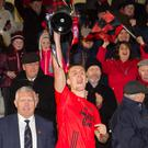 Glenbeigh-Glencar captain, Colin McGillycuddy raises the Munster Club Junior Football Championship trophy after his side defeated Gabriel Rangers of Cork in last Sunday's final