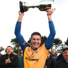 Beaufort Captain Nathan Breen with the Michael O'Connor Memorial Cup after Beaufort defeated Milltown/Castlemaine in the Mid Kerry Senior Football Championship final at J.P.O'Sullivan Park, Killorglin on Sunday. Photo by Michelle Cooper Galvin