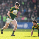 Paul Geaney goes past Caolan Ward of Donegal on his way to scoring his side's second goal during the Allianz League Division 1 match between Donegal and Kerry at O'Donnell Park in Letterkenny. Photo by Sportsfile