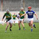 Jack Goulding of Kerry and Matthew Whelan of Laois during the game at Austin Stack Park