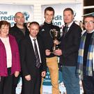 John Long Chairman Chapter 23 (third from left) and Tim Murphy Chairman Kerry County Board who made a special presentation to Aiden Roche Chairman, Colin Mcgillicuddy Captain and Brian Sugrue of Glenbeigh Glencar to mark their Club's All Ireland achievement with (left) Mary O'Shea Tres. Chapter 23 Credit Union at Killarney Credit Union on Monday. Photo by Michelle Cooper Galvin